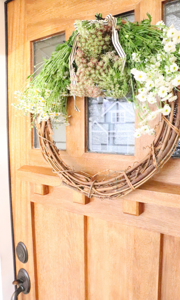farmhouse front door with spring wreath