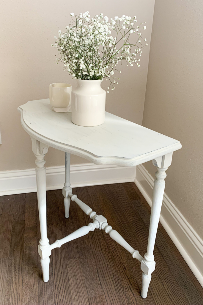 Learn how to refinish and paint an old wood farmhouse table with this simple tutorial. Uses milk paint!   #diy #farmhouse #wood #refinish #white #projects #simple #cheap #easy #doityourself #sidetable #homedecor #livingroom #decor #paint
