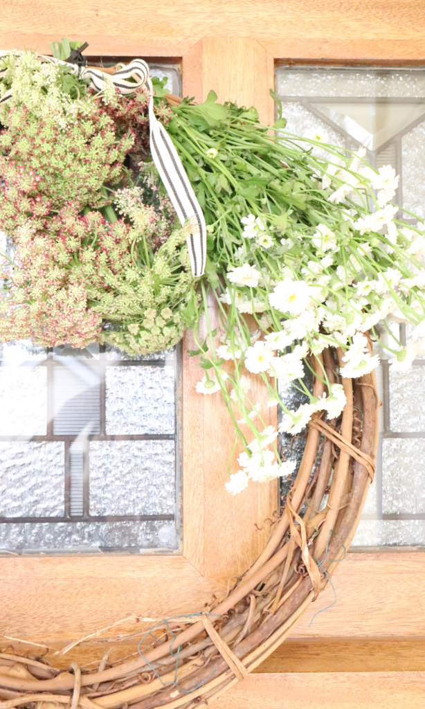front door wreath with chamomile in a farmhouse