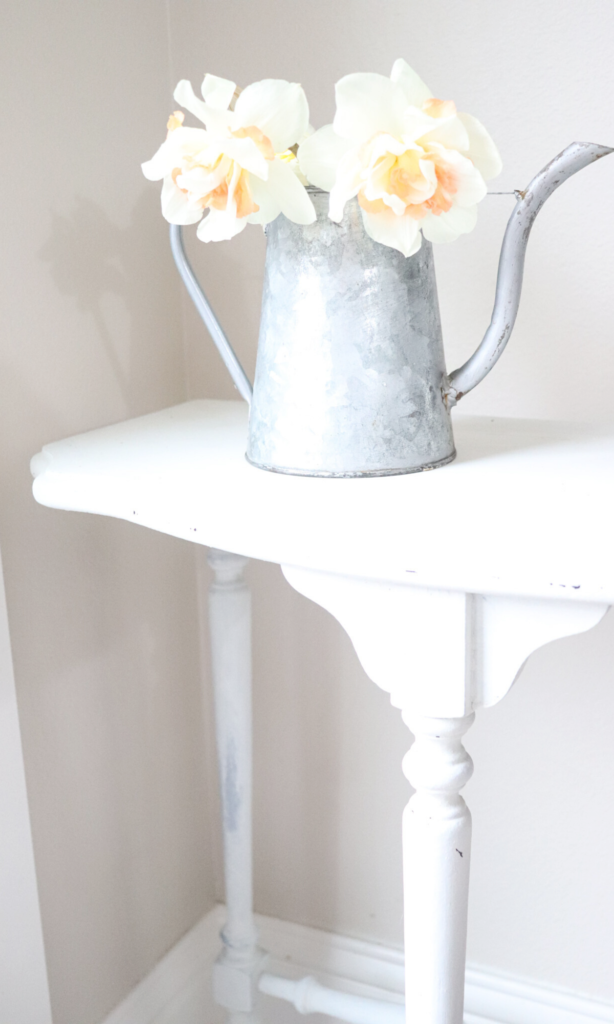 simple flowers in a watering can - farmhouse decor
