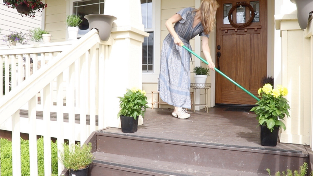 cleaning the porch to prepare for decorating at the homestead