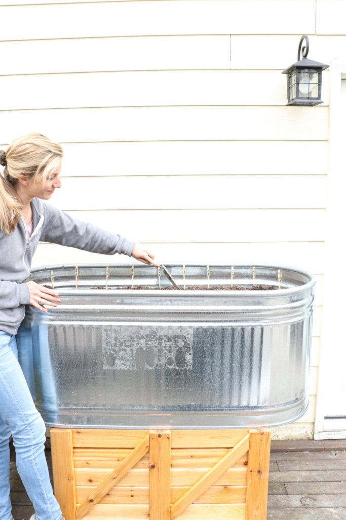 Planting a spring planter box at the farmhouse