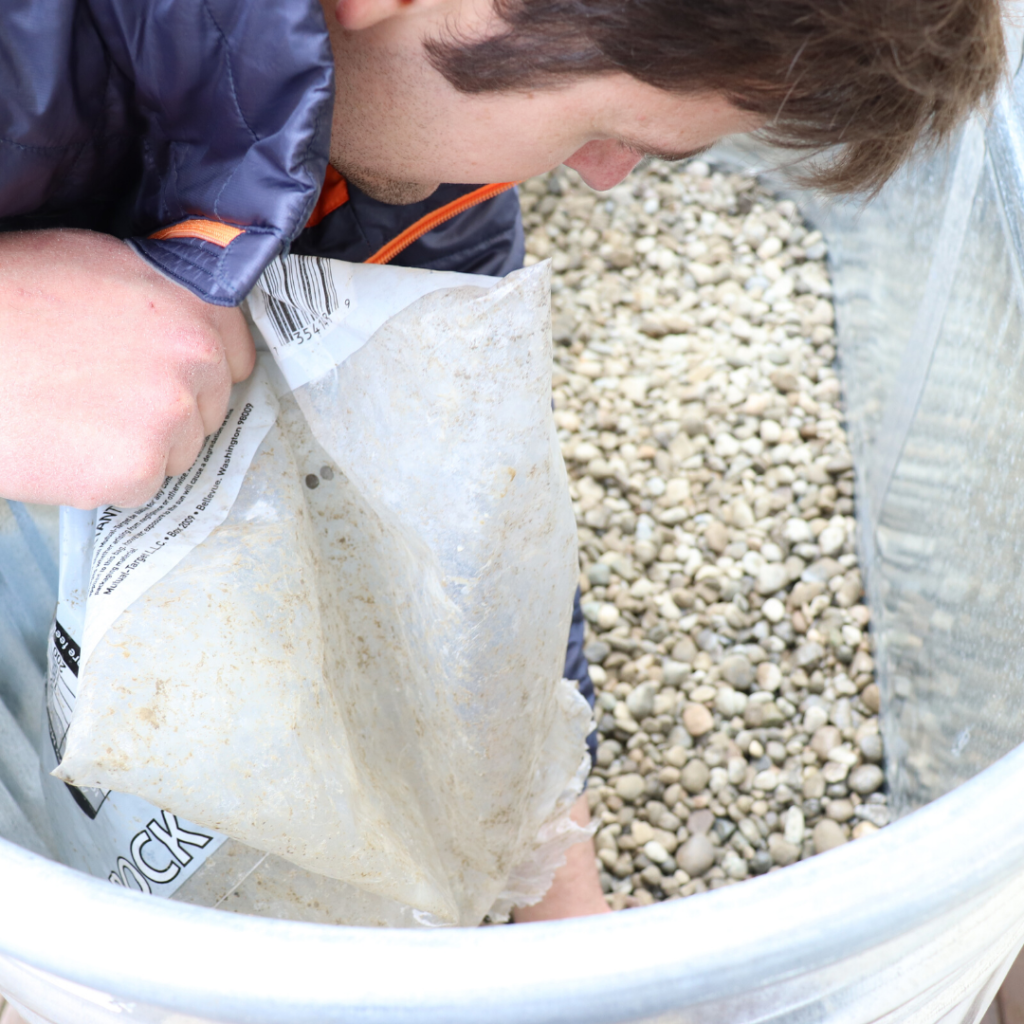 adding drain rock to the garden bed
