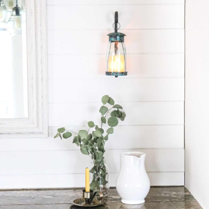 charming farmhouse shiplap accent wall with vintage tin candle holder