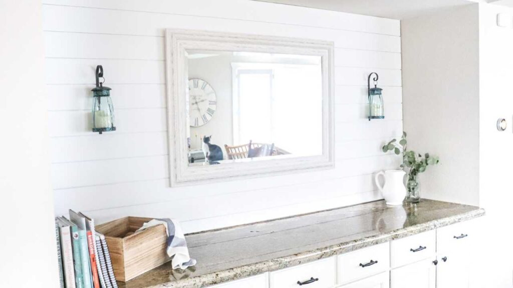 This charming farmhouse shiplap accent wall can give any modern home that classic old world farmhouse style. Learn this easy shiplap DIY to turn any wall of your home into charming farmhouse shiplap.