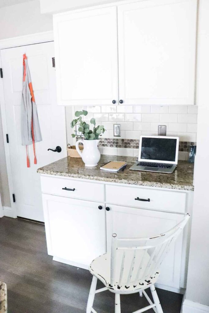 I am excited to finally share our farmhouse kitchen office nook reveal. I've been using this space as a desk for a long time and have finally organized it so it functions much better. Keep reading for kitchen office organization tips and tricks!  #farmhouse #kitchen #office #organization #nook #desk #homeoffice #organizationhacks #clean #recylce #organize