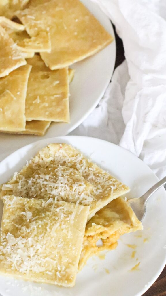 This simple recipe for homemade ravioli without a pasta maker uses einkorn flour and savory butternut squash filling. Perfect for a cool fall evening to enjoy the flavors of fall with the health benefits of einkorn flour.   #fallrecipes #homemaderavioli #butternutsquash #einkornravioli #einkorn #pasta #nopastamaker #withoutamold